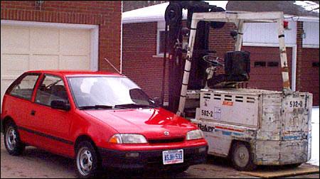 Suzuki Swift and Forklift
